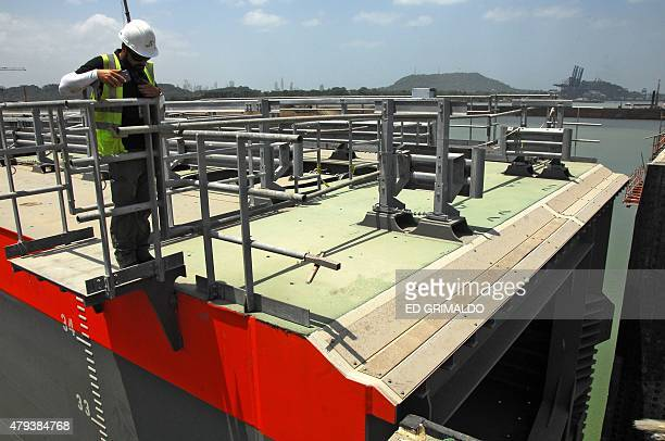 An employee observes the Cocoli lockgates during a test on July 3 7 km from Panama City AFP PHOTO / ED GRIMALDO