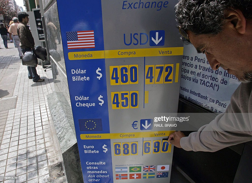 An employee of a bureau de change places the day s last prices for