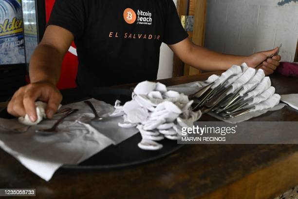 An employee of a hotel where bitcoins are accepted is photographed during his workday on the beach of El Zonte, La Libertad, El Salvador on September...