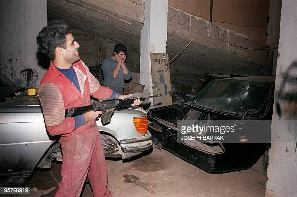 An employee of a manufacturer of bulletproof limousines uses a submachine to test safety body and glasses of a car 20 November 1987 in Christian East...