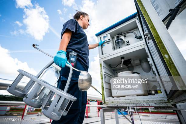 An employee of a sewage treatment plant takes a sample of the sewage water on July 22 2020 in 'sHertogenbosch The water is examined for among other...