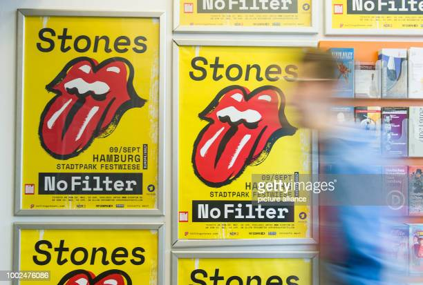 ILLUSTRATION An employee of a ticket shop sticks a poster for the tour of the Rolling Stones to a wall in Hamburg Germany 12 May 2017 The online...