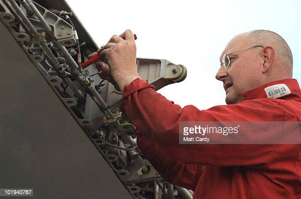 An employee of Air Salvage International continues the process of dismantling a Airbus A320 on June 9, 2010 in Kemble, England. The aircraft is one...
