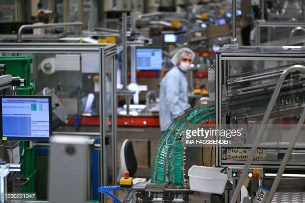 An employee of ALMO-Erzeugnisse Erwin Busch GmbH works at the company's production facility for disposable syringes in Bad Arolsen, central Germany,...