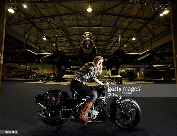 An employee of Bonhams auction house sits on a Brough Superior 1931 SS100 in the RAF Museum ahead of their sale of 100 pre1950's motorcycles on...
