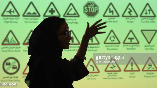 An employee of Careem a chauffeur driven car booking service talks during a training session for new female drivers known in the company as...
