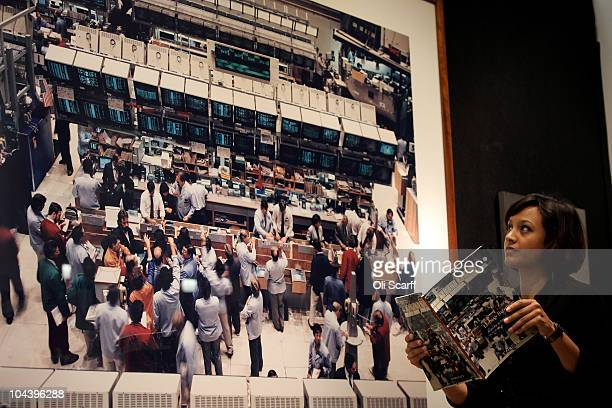 An employee of Christie's auction house views a photograph by Andreas Gursky entitled New York Mercantile Exchange which is estimated to sell for...