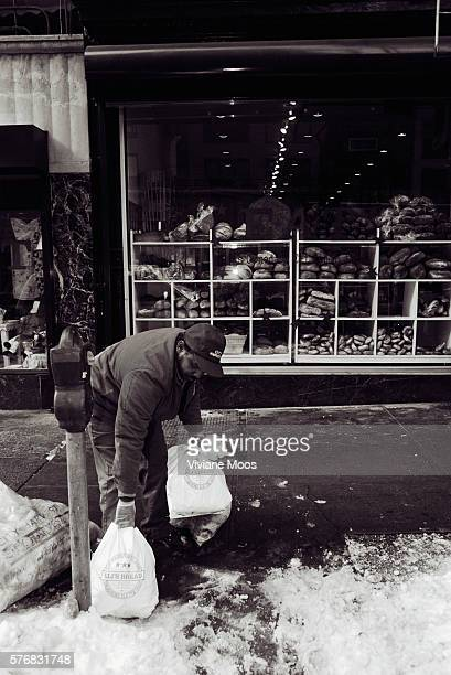 An employee of City Harvest, a nonprofit food rescue and hunger relief program in New York City, collects bread donations from bakeries and gourmet...