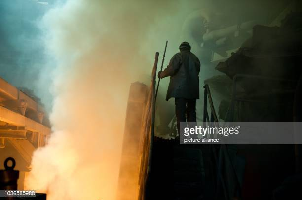 An employee of company Peiner Traeger works at an electric arc furnace at the steel mill in Peine Germany 16 August 2013 Photo Sebastian Kahnert |...