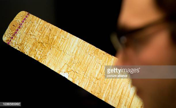 An employee of company ScanBull Software inspects the Golden Letter of Burmese king Alaungpaya from 1756 at Gottfried Wilhelm Leibniz Library in...