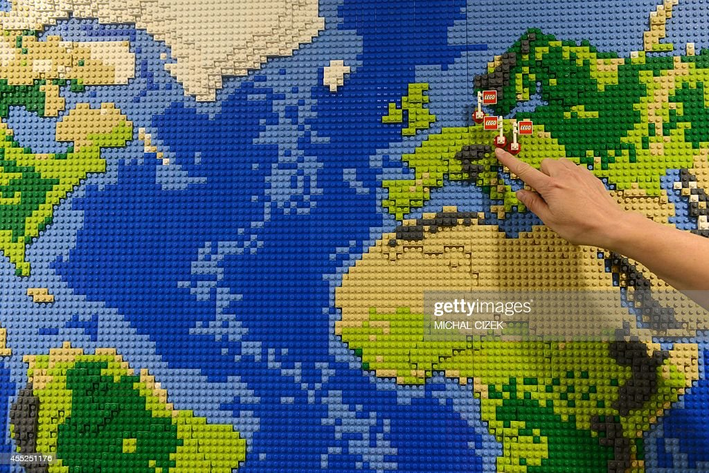 An employee of Danish firm Lego shows the Lego factories in Europe ...