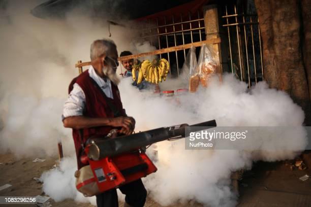 An Employee of Dhaka North City Corporation sprays pesticide for kill mosquitoes on 16 January 2019 in Dhaka University area Bangladesh