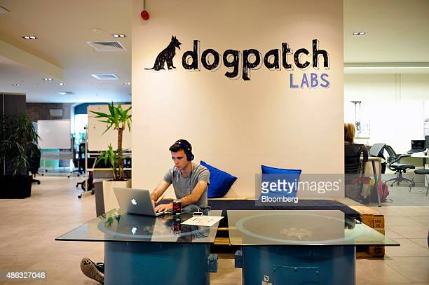 An employee of Dogpatch Labs uses an Apple Inc. Laptop computer in CHQ shopping mall in Dublin, Ireland, on Thursday, Sept. 3, 2015. Former Coca-Cola...