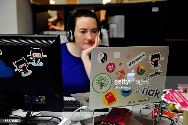 An employee of educational organization CoderDojo uses an Apple Inc. Laptop computer in Dogpatch Labs inside the CHQ shopping mall in Dublin,...