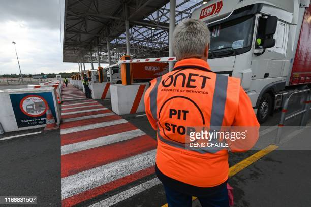 An employee of Eurotunnel stands after checking a truck on its way to Great Britain during a day of test in case of Brexit at the entrance of the...