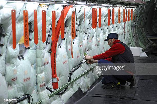 An employee of Franco-Italian aeronautics manufacturer ATR works on an assembly line on January 23, 2013 at the Toulouse factory. ATR registered for...