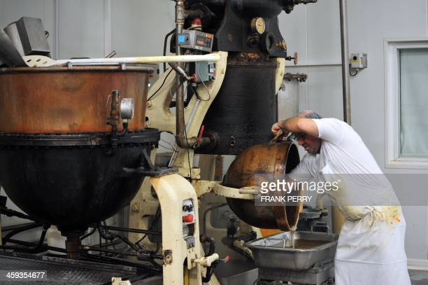 An employee of French candy manufacturer BontePinson works on the preparation of Berlingots nantais traditionnal candies on December 13 2013 on the...