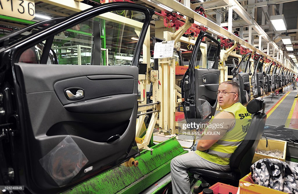 An employee of French carmaker Renault are at work on an assembly line on May 25, 2010 in Douai, northern France.