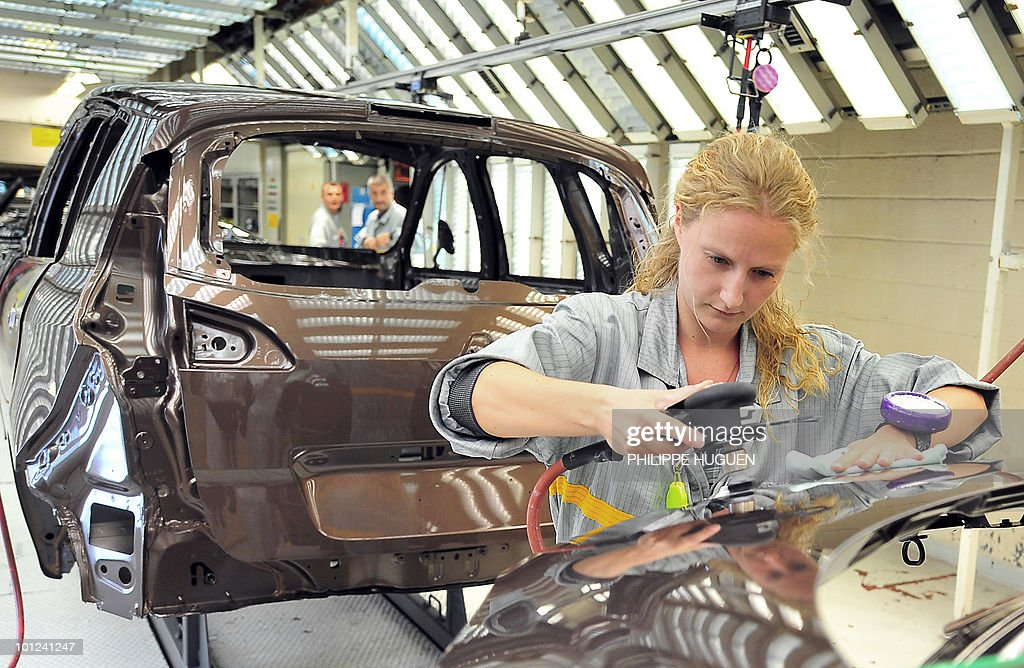 An employee of French carmaker Renault is at work at the painting department of a plant on May 25, 2010 in Douai, northern France.