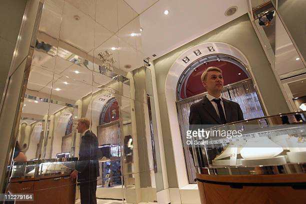 An employee of Garrard jewellers at work in the boutique area of their flagship store in Mayfair on April 6 2011 in London England Garrard is the...