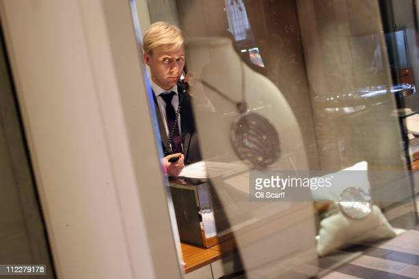 An employee of Garrard jewellers works in the boutique area of their flagship store in Mayfair on April 6 2011 in London England Garrard is the...