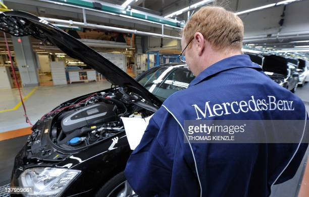 38e868b48f An employee of German car maker MercedesBenz makes the final inspection of  a Sclass car at