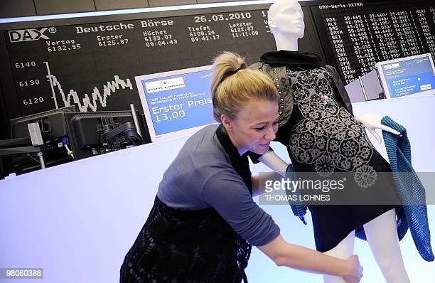 2ea4eea30f6297 An employee of German fashion company Tom Tailor installs a shop window  dummy at the Frankfurt