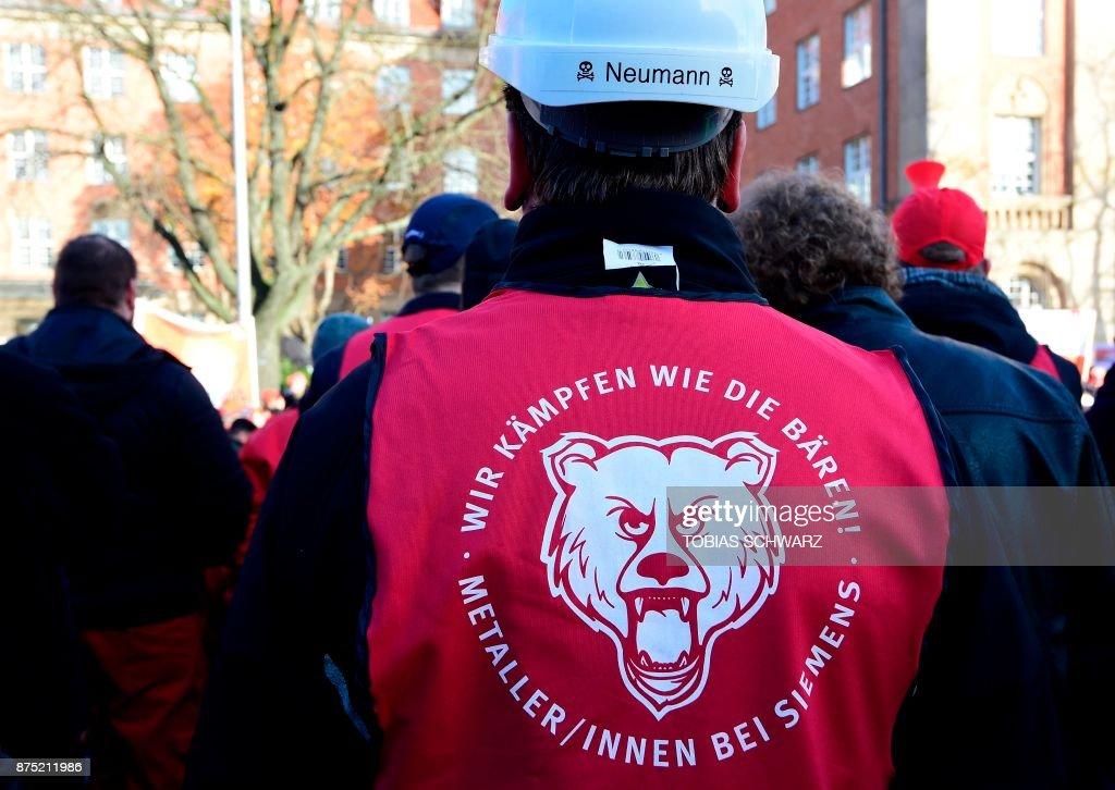 An employee of German industrial conglomerate Siemens wears a vest
