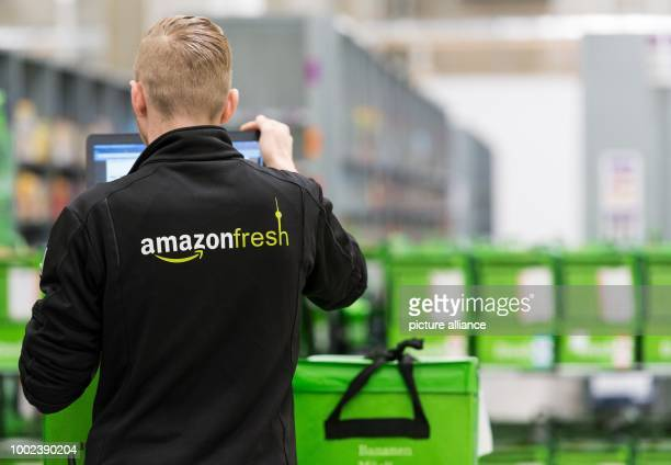 An employee of grocery delivery service Amazon Fresh at the company depot in Berlin Germany 18 July 2017 Amazon Fresh started in Berlin and Potsdam...