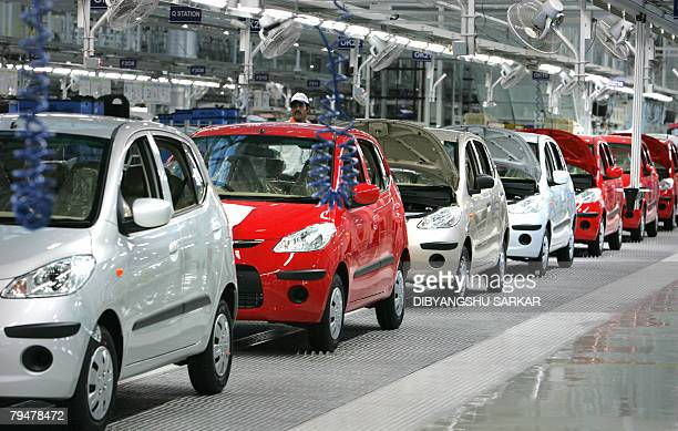 An employee of Hyundai Motor India Limited works in the newly inaugurated auto plant in Sriperumbudur around 45 kms north of the southern Indian city...