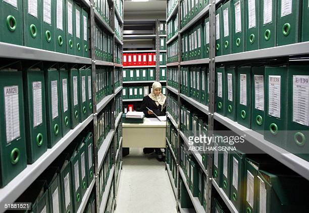 An employee of IER classifies files of victims of the socalled 'annees de plomb' a period of a brutal repressions at IER headquarters in Rabat 20...