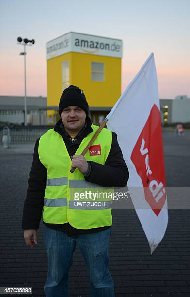 An employee of internet retail giant Amazon stages a strike in front of the company's logistics center in Bad Hersfeld central Germany on December 16...