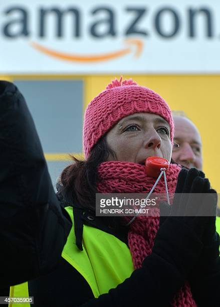 An employee of internet retail giant Amazon stages a strike in front of the company's logistics center in Leipzig eastern Germany on December 16...