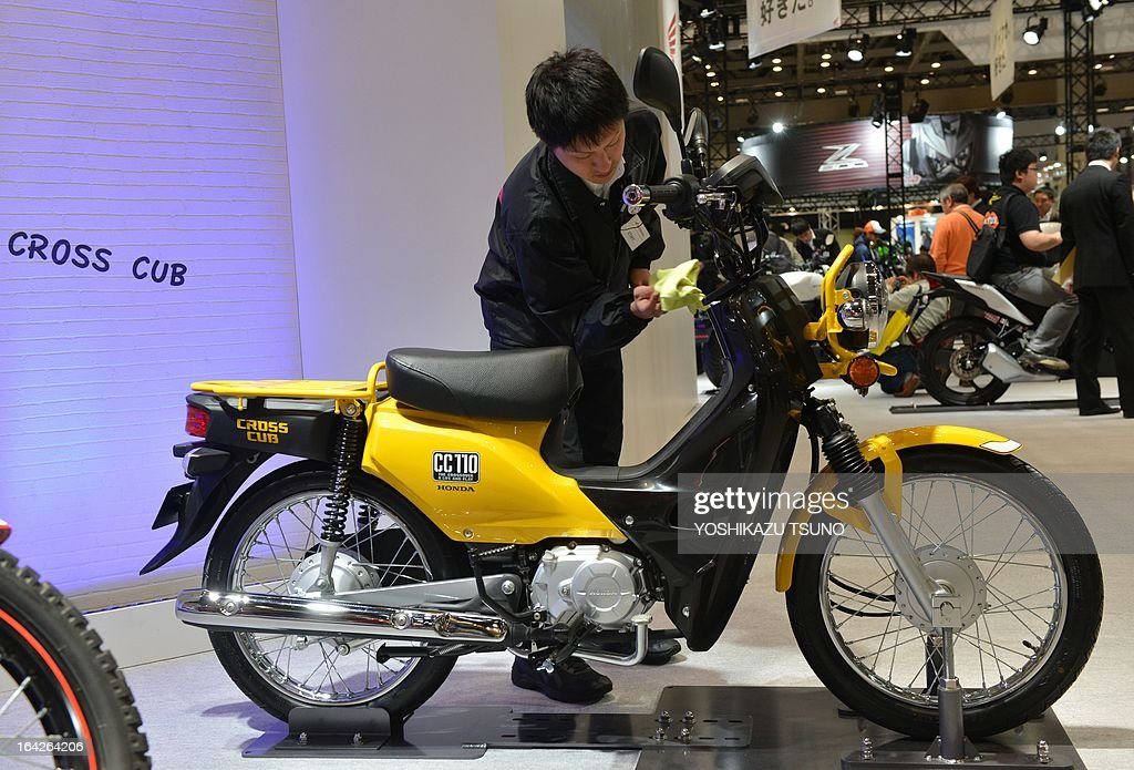An Employee Of Japanese Motorcycle Giant Honda Motor Dusts The Prototype Model Cross
