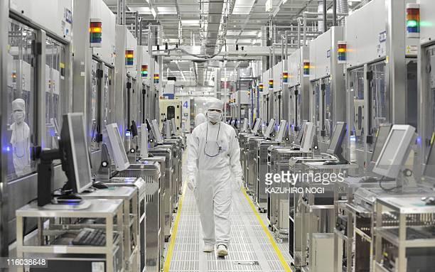An employee of Japan's microprocessor maker Renesas Electronics works at the company's Naka wafer fabrication factory in Hitachinaka Ibaraki...