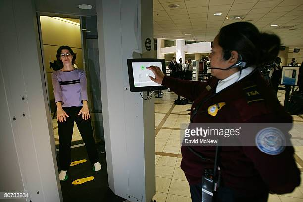An employee of L3 Communications Security and Detection Systems is scanned inside their ProVision whole body imaging machine which can see through...