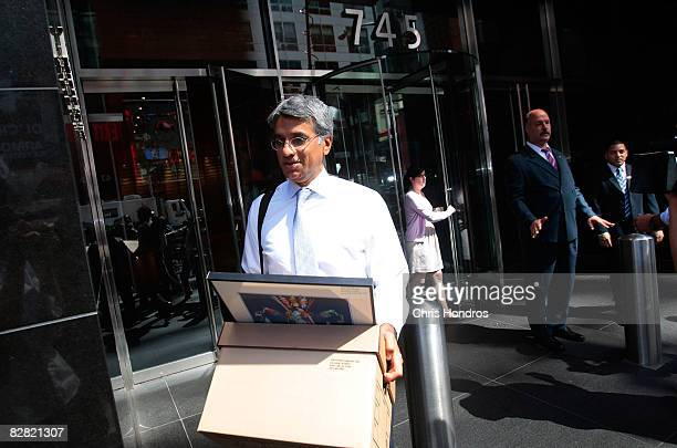 An employee of Lehman Brothers Holdings Inc carries a box out of the company's headquarters September 15 2008 in New York City Lehman Brothers filed...