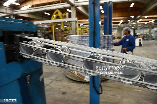 An employee of Massilly a company which manufatures food metallic packaging works on a line of cans covered by a polish containing the chemical...