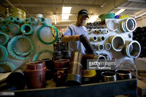 An employee of Midway Supply Company fill an order of valves and fittings for a coal bed methane customer on June 15 2006 in Gillette Wyoming The...