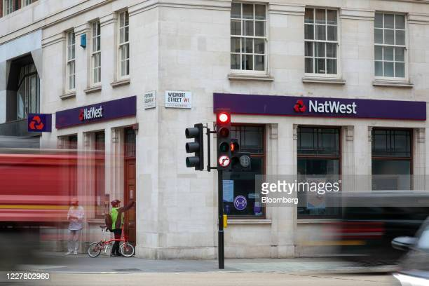 An employee of NatWest Group Plc locks a door at a bank branch in London, U.K., on Monday, July 27, 2020. The Treasury is in talks with the U.K.'s...