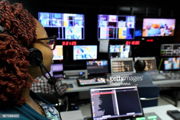 An employee of NTV works at the studio of Kenyan 'Nation Media Group' in Nairobi on January 19 2018 / AFP PHOTO / SIMON MAINA