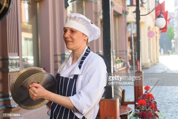 An employee of Paddy Whelans Irish Pub Sports Bar takes a part of Pots Revolution in Riga Latvia on May 28 2020 Members of Association of Restaurants...