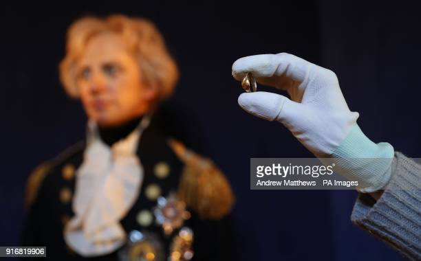 An employee of Portsmouth Historic Dockyard holds up a betrothal ring Vice Admiral Lord Nelson gave to his mistress Emma Hamilton on the eve of his...