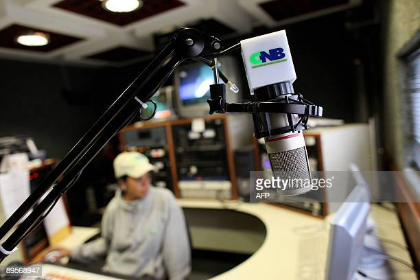 An employee of private radio station CNB waits inside the studio in Caracas on August 2 2009 34 broadcasters were taken off the air due to the...