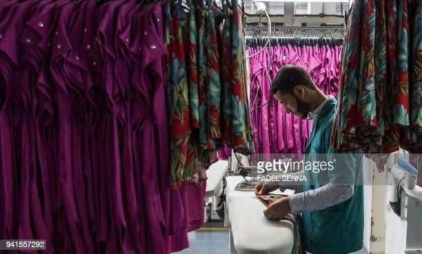 An employee of Still Nua's fashion works at a textiles factory in an industrial park connected to a free-trade zone in the Moroccan city of Tangiers...
