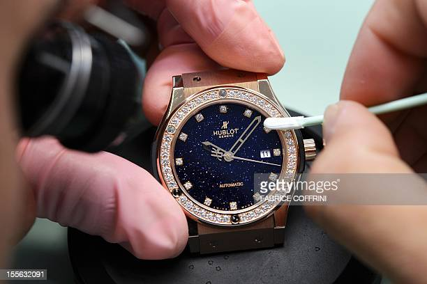 An employee of Swiss watchmaker Hublot works on a watch intended for the Chinese market on October 23 in Paudex western Switzerland Successdriven...