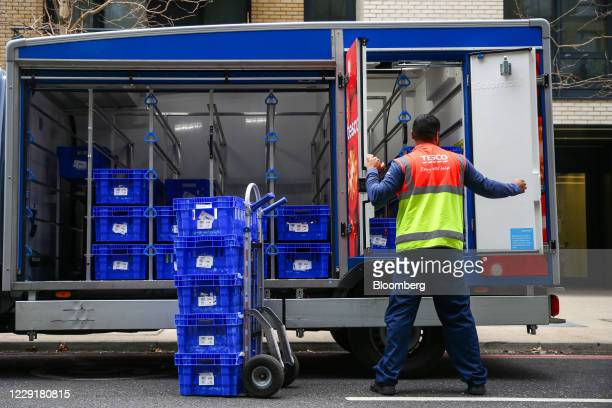 An employee of Tesco Plc unloads groceries from a truck as he prepares a delivery in London, U.K., on Wednesday, Sept. 30, 2020. Covid-19 lockdown...