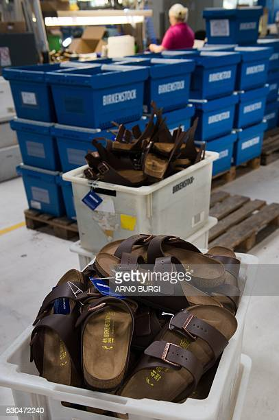 An employee of the Alsa GmbH company in Goerlitz eastern Germany works on the production of Birkenstock shoes on May 10 2016 / AFP / dpa / Arno Burgi...