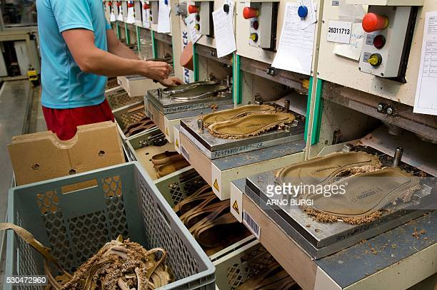 An employee of the Alsa GmbH company works on the production of Birkenstock shoes in Goerlitz eastern Germanyon May 10 2016 / AFP / dpa / Arno Burgi...