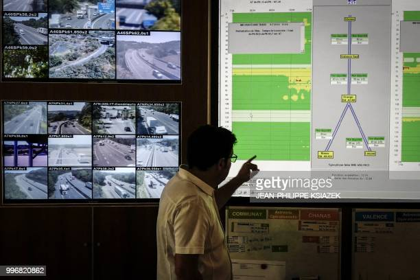 An employee of the Autoroutes du Sud de la France watch video monitors at the security headquarters on July 9 2018 in Valence southeastern France